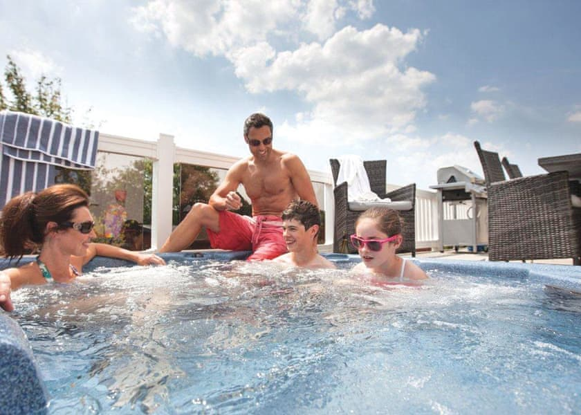 Family enjoying and laughing while in the hot tub