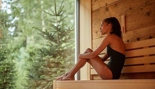 Lady relaxing at Aqua Sana Treetop Sauna