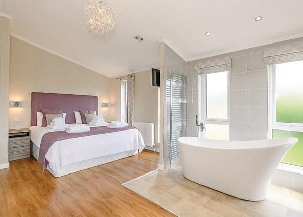 Lode Hall Lodges bedroom with bath tub